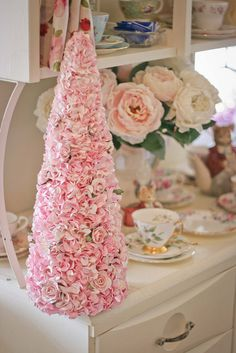 Rose tree.  Love the shabby chic setting!