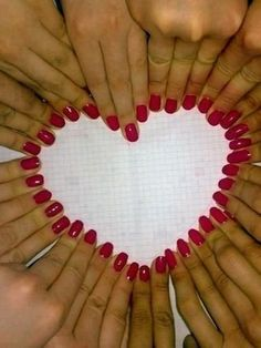 Capture a shot of you and your bridesmaids' nails forming the shape of a heart