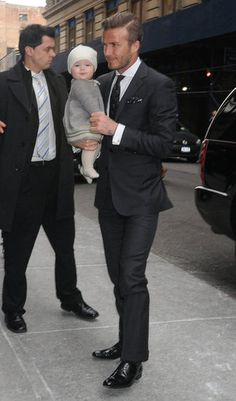 David Beckham...hot dude in a nice suit with his little girl.  There is NOTHING wrong with this picture!