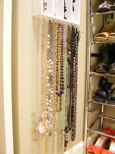 Cutlery Tray for Jewelry! Like the idea of hooks on the inside of door in bedroom cupboard for hanging necklaces.