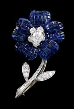 VAN CLEEF & ARPELS Mystery-set Diamond & Sapphire Flower Pin from…