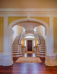 A handsome double staircase leads to the second level.