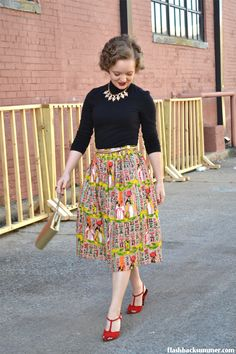 I love this look! The skirt and shoes are so vibrant and fun, and I like the glam the gold accessories bring!