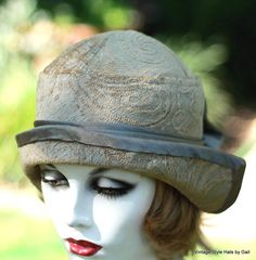 Womens 1920s Great Gatsby vintage style cloche hat made in a sage green-taupe art deco napped chenille fabric. It has a matching charmuse satin pleated