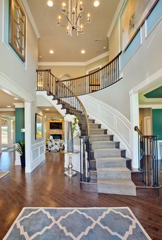 The stunning Chelsea Foyer at the Estates at Cedarday, MD! Curved Staircase, Grand Staircase, Staircase Design, Staircase Landing, Winding Staircase, Staircase Ideas, Dream House Interior, Home Interior Design, House Stairs
