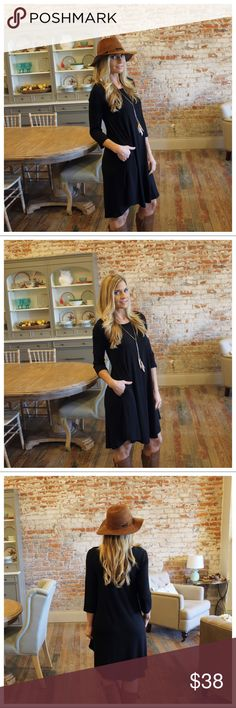 """Black 3/4 sleeve dress with pockets Modeling size small.  Bust laying flat: S 17"""" M 18"""" L 19"""" XL 20"""" Length S 36"""" M 37"""" L 38"""" XL 39"""". 67% polyester 28% rayon 5% spandex.  Add to bundle to save when purchasing.  IR4501208.RS1300 Infinity Raine Dresses"""