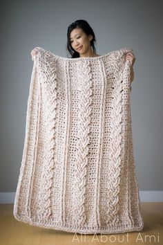 Chunky braided cable crochet blanket - seems like a really simple way to get such beautiful braiding.