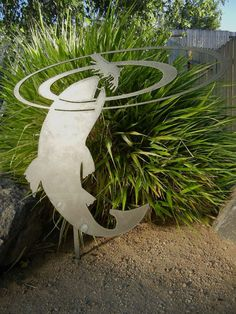 Fly fishing yard sculpture. How do people think of things like this? I love it!