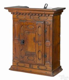 Diminutive pine hanging cupboard, late 18th c., with a dentil molded cornice over a case and door - Price Estimate: $800 - $1200