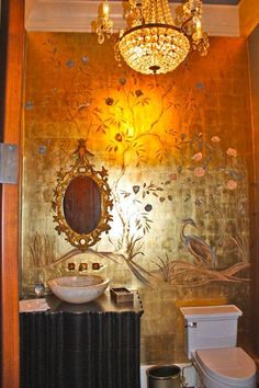 Ornate powder room with gold leafing and a Gracie-inspired painted design on one wall. Segreto Finishes.
