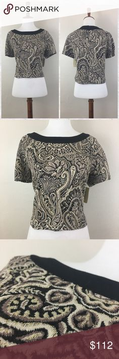 """ECI Nordstrom Paisley Jacquard Crew Neck Crop Top *Condition: NWT  *Neckline: Crew *Sleeve style: Cap *Fit: Crop *Features: Slit at Shoulder shown in photo 4 *Closure: Double button at nape *Shell: 69% Polyester 25% Rayon 3% Nylon 2% Lurex 1% Spandex Exclusive of Decoration  *Care: Machine washable *Measurements are approx & taken lying flat *Sleeves 6"""" *Bust 40"""" *Shoulder to hem 18"""" *Stored in non-smoking pet free home ECI Tops Crop Tops"""