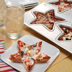 Star pizzas! Perfect size for movie night snacks - cool, never thought of doing this with shaped pans before (could also just use cookie cutters and place on a tray...cheaper that way if you don't have the pans)