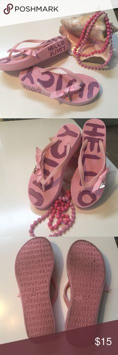Juicy couture pink flip flops Sz 7 Hello Juicy pink platform sandals. So cute with a little bow and heart charm on each one. A little under 2 in platform at the heel. Pre loved, but plenty of life left! Juicy Couture Shoes Sandals