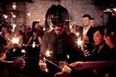 Real wedding: Leslie Rivas and Collin Kelly's fashionable Big Easy affair. Houston-based leather designer Chad Landry, at center, wears a custom mask at the Rivas-Kelly wedding reception.  Photo: Arthur Garcia / Select Studios