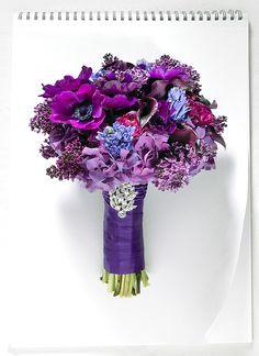 #weddingbouquet Dark purple lilac, blue hyacinth, purple anemone, burgundy ranunculus, eggplant calla lily, and purple hydrangea wrapped in purple satin ribbon.