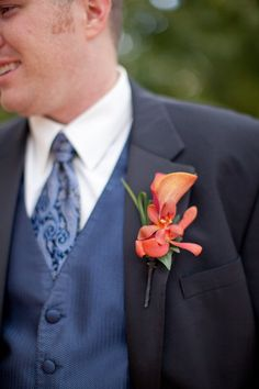 Boutonnier for the guys only with purple flower instead of pink
