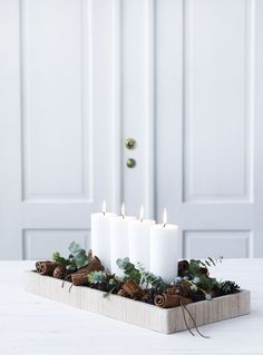 Tray with candles, greenery and pine cones. Love bringing in wintery bits of nature at Christmas time.
