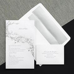 Shimmers and sparkles and romance - they're what this invitation is all about! This large, uniquely shaped invitation card of white shimmer paper is accented with silver foil filigree and a pair of love birds. Your names appear at the top as shown and your wording is below the design.