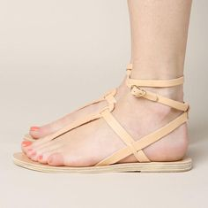 The Ancient Greek Estia Thong Ankle Strap Sandal is a handmade leather sandal. It features wraparound ankle strap with buckle closure. - Materials: Leather - Made in Greece - Size: True to size, US wo