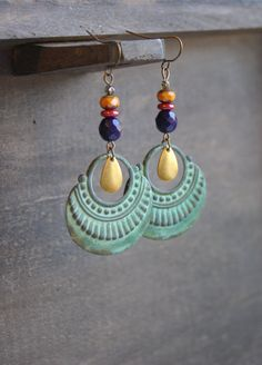 Hey, I found this really awesome Etsy listing at https://www.etsy.com/listing/168683569/tribal-medallion-earrings-patina