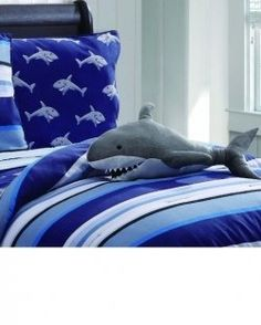Designing a shark bedroom? Take a look at these totally cool ideas for creating an awesome shark themed kid's bedroom. Here you'll find suggestions...