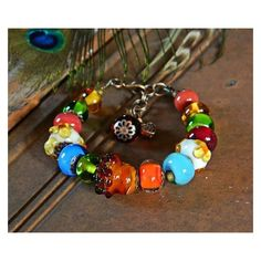Colorful Artisan Lampwork bracelet, Acorn bracelet Fall Handmade... ❤ liked on Polyvore featuring jewelry, bracelets, bohemian jewelry, beading jewelry, murano glass jewelry, boho chic jewelry and multicolor jewelry