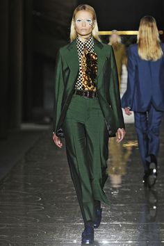 """Miuccia Prada's slick silk suits, printed blouses, and ties recalled — if not exactly literally — the turquoise, tight, bespoke costume from """"Life on Mars"""".   - ELLE.com"""