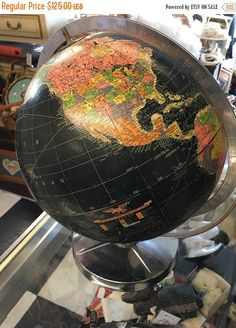 1940 Replogle 12 inch starlight globe Black paper globe on a mid century stainless steel stand There is a bit of wear to the stand and one of the