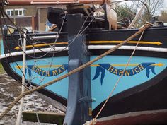 The decorated stern of the sailing barge Edith May moored at lower Halstow on the river medway {shared]