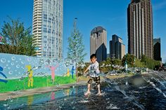 The splash pad at Dallas' new Klyde Warren Park is a big draw for children.