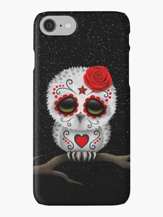 This cute design by artist Jeff Bartels features a baby snowy owl chic with large black eyes and a single rose on its head. Swirling lines and dot patterns decorate the small white owl in the tradition of Day of the Dead sugar skulls. The bird is sitting down with its feet beside each other and is looking forward with its head slightly tilted to one side. The over sized head and small body along with the details in the furry feathers create a beautiful combination of a cartoon and realistic…