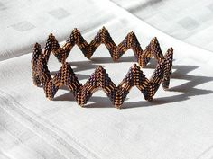 Fledged: The Bangle. by geometricjewels, via Flickr