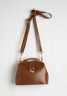 Enroll with It Bag. Whatever lessons and learnings come your way, go with the flow looking perfectly scholarly with this petite brown purse! #green #modcloth