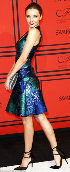 Miranda Kerr wore a shapely Proenza Schouler dress with blues and greens