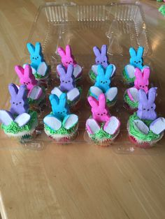 Easter bunny cupcakes. I cut the bottom of the peeps off to make them more stable on top of the cupcake and thought why don't I use this for feet!