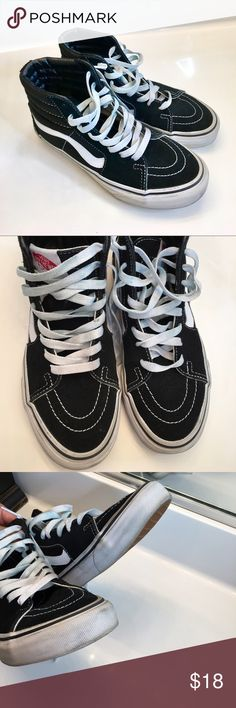Vans high top sneakers black and white Vans black and white hightop sneakers. I bought these for my nine-year-old son but he only wore them once said it bother his pinky. Size youth 4.5 Vans Shoes Sneakers