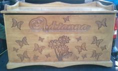 Toy box  storage chest personalized Handcrafted daisy and butterfly carved design toy chest or storage box. The flowers and butterflies are machine carved. Stained with ipswich pine. Several coats of poly were applied to give it a nice smooth shiny look.  by cmcraftedtreasures on Etsy, $400.00