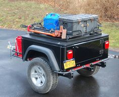 Interesting Tventuring on repurposing a HF ATV cargo carrier, in this example for a Dinoot Jeep Trailer, check it out at http://tventuring.com/trailerforum/thread-72.html