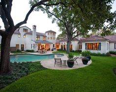 Classically Spanish custom tile roof and outdoor pool in Astleford Interior's trademark Hacienda Chic style
