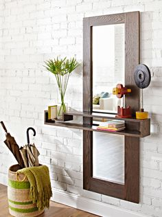 Make an Entry Mirror  Dress up an entryway with a modern-look mirror and floating shelf. Made from a few oak boards and hardboard, this project can be completed in one weekend.