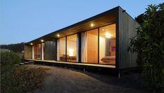 prefab, big long porch, big windows