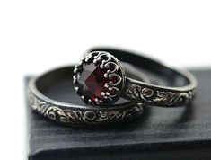Garnet Wedding Set, Natural Almandine Garnet Engagement Ring, Personalized Women's Wedding Band, Oxidized Silver Renaissance Bridal Jewelry is part of jewelry Set Wedding - fifthheaven etsy com Gothic Wedding Rings, Skull Wedding Ring, Gothic Engagement Ring, Silver Wedding Rings, Silver Rings, Garnet Engagement Rings, Gothic Rings, Steampunk Wedding, Ruby Rings