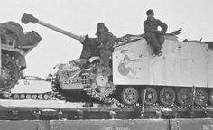 StuG 3 tanks being transport by ordinance train wiith their crews alongside.