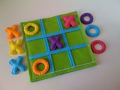 This is a tactile version of Tic Tac Toe, complete with a raised grid, plush Xs and Os and braille. The entire game can be stored in the pouch that also serves as the game board.
