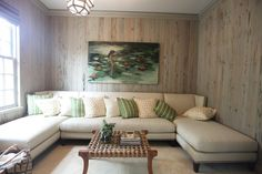 Walls, sectional, coffee table, light fixture