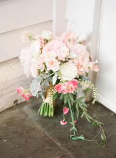 rose, ranunculus, tulip, sweet pea, and dusty miller bouquet