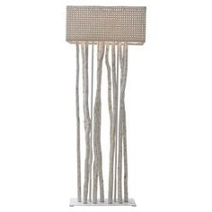 """Handcrafted wood and rattan floor lamp with a coordinating shade.  Product: Floor lampConstruction Material: Wood and rattanColor: IvoryFeatures: HandcraftedDimensions: 70"""" H"""