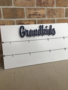The string art family or grandkids board in the pictures measures approximately 26x15. It can be done in string color of your choice and the color of stain or paint you prefer. It will come with 2 rows of 4 clothes pins/hangers for hanging your family or grandkids pictures. If you