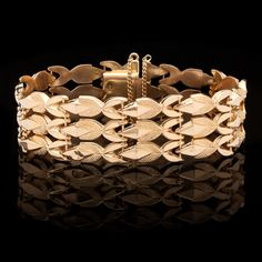 Retro 18Kt Yellow Gold Bracelet Delicately Drapes on the Wrist. The bracelet is 18mm in width and a size 7.5, weighing 25 grams.