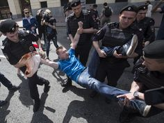 Russian police officers detain gay rights activist Nikolai Alexeyev during an attempt to hold a gay demonstration in Moscow.  Pavel Golovkin, AP